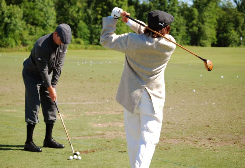 Justin Rose and Rickie Fowler test out classic golf balls, clubs, and attire at a three-hole charity event at New Orleans' 2012 Zurich Classic.