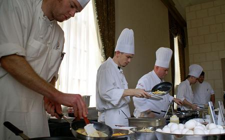 Chefs prepare brunch at one of New Orleans' classic restaurants.