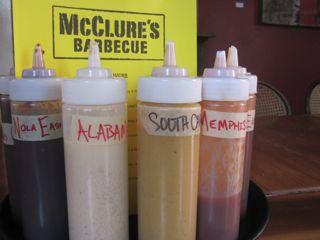 The sauce selection at McClure's BBQ represents the wide regional range of barbecue traditions now taking root.