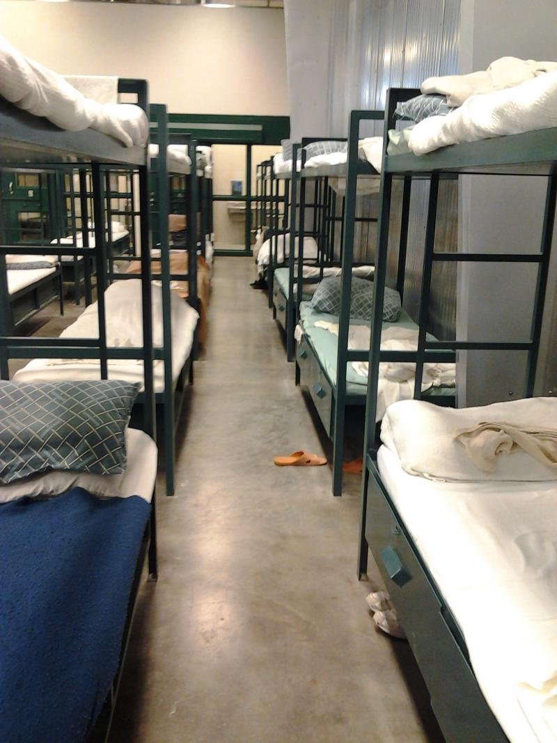 Inmates at the Temporary Detention Center sleep in dormitory-style bunks.