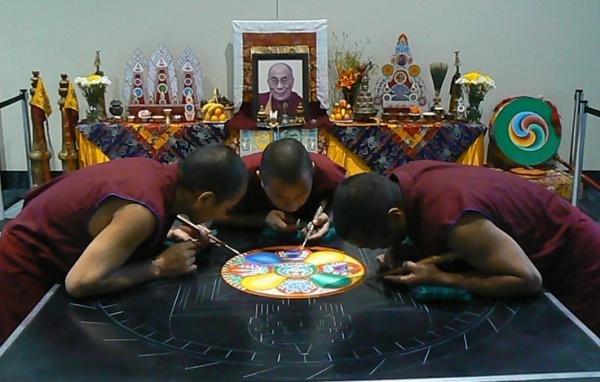 By the time it is finished on Friday morning, the mandala will fill up the entire table. Shortly thereafter, it will be swept away and ceremonially deposited into the Mississippi River.
