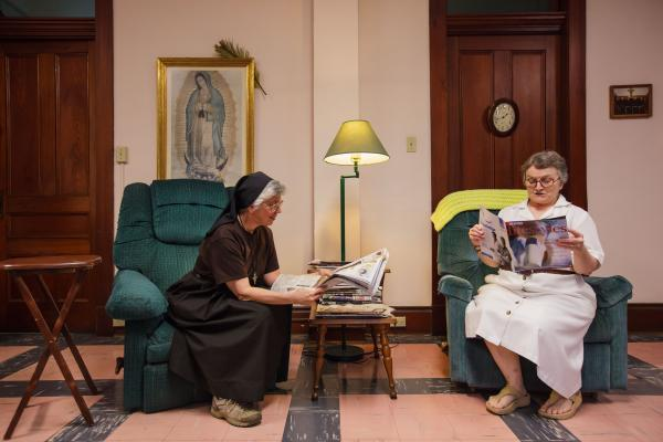 Sister Charlene Toups (left) and Sister Eileen-Clare Duffy catch up on news in the community room of St. Clare's Monastery a couple blocks from Audubon Park.