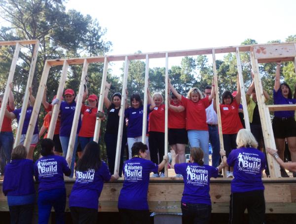 A Habitat For Humanity Women's Build crew framing a house.