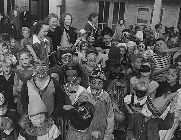 Children gather to celebrate Halloween in 1943.