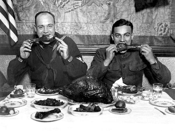 Soldiers feast on a traditional Thanksgiving supper during World War I. Thanksgiving and Hanukkah converge this year in an unlikely occurrence that won't happen for another 77,000 years.