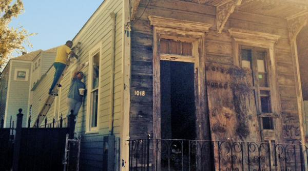 A shotgun house in the Tremé neighborhood of New Orleans gets new paint.