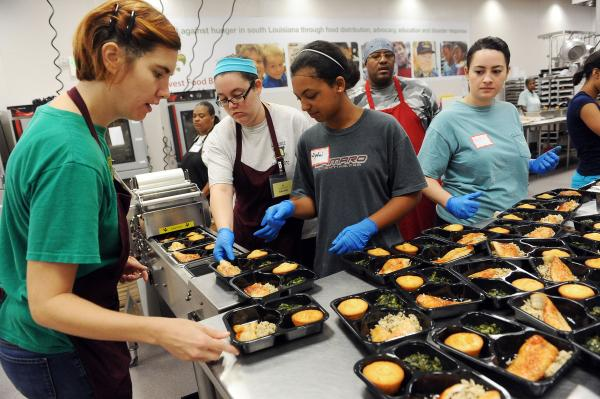 Staff and volunteers prepare school dinners at the Second Harvest Food Bank Community Kitchen.