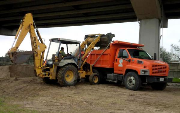 Louisiana Department of Transportation and Development workers preparing road salt and sand ahead of the winter storm scheduled to impact the region.