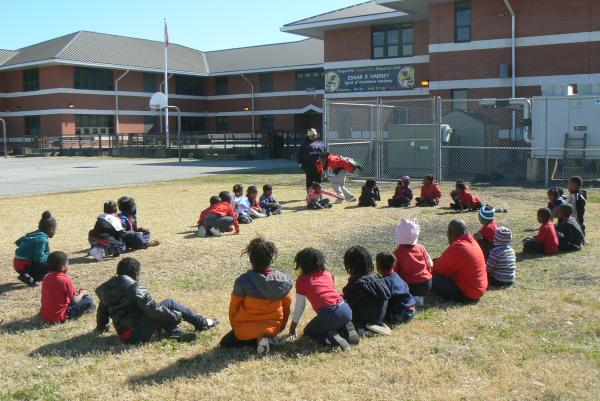 Students at Edgar P. Harney elementary school play Duck Duck Goose during one of their supervised recess breaks, organized by Playworks.