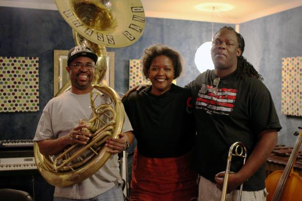 Philip Frazier and Gregory Veals of Rebirth Brass Band flank Gwen Thompkins at Marigny Recording Studio