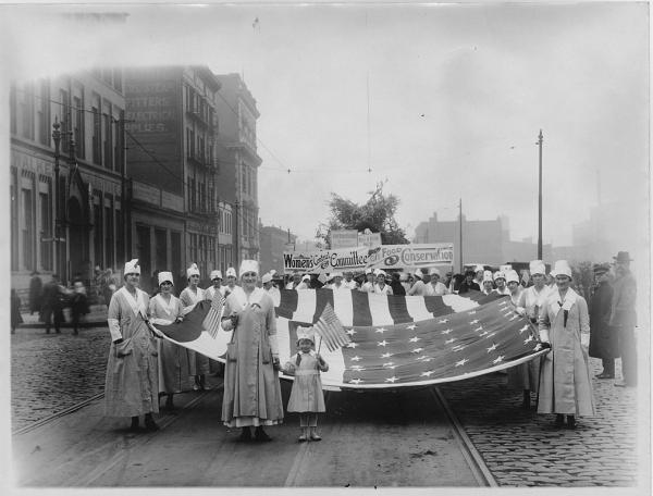 Women gather together in the name of food in 1917. The first International Women's Day occurred in 1911 and has become a month-long historical appreciation.