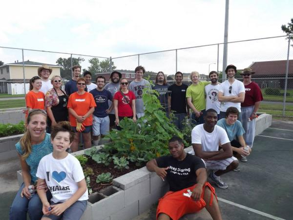 Volunteers, including members of the U.S. Marine Corps and students from Tulane Medical School, pose with the literal and figurative fruits of their labor at the Federal City Community Garden.