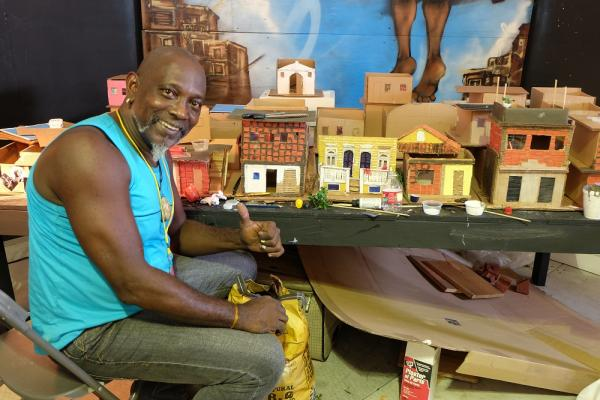 Sergio Cezar, an artist based in Rio de Janiero, displays his favela sculptures in this year's Cultural Exchange Pavilion, the Casa Do Brazil.