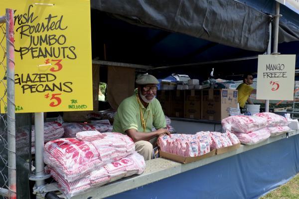 Wali Abdel-Raoof, selling jumbo peanuts. Abdel-Raoof has a peanut roasting factory on Jackson Ave. in Central City.