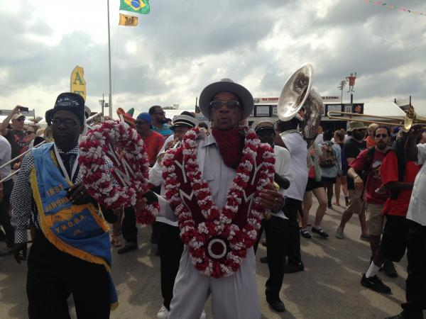 Jazz Fest Second Line: Tornado Brass Band with Young Men Olympia Aid, New Look, and First Division Social Aid and Pleasure Club.