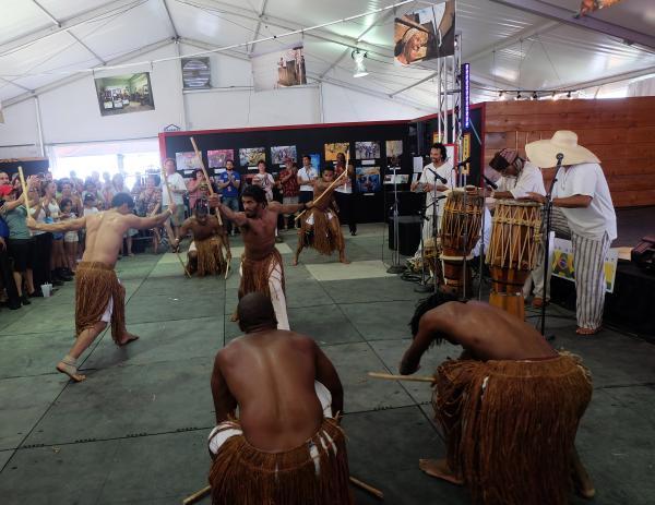 Capoeira, a traditional Brazilian martial art, in the Casa Do Brasil tent.