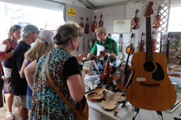 A string instrument repair demo with Calvin Ardoin in the Louisiana Marketplace.