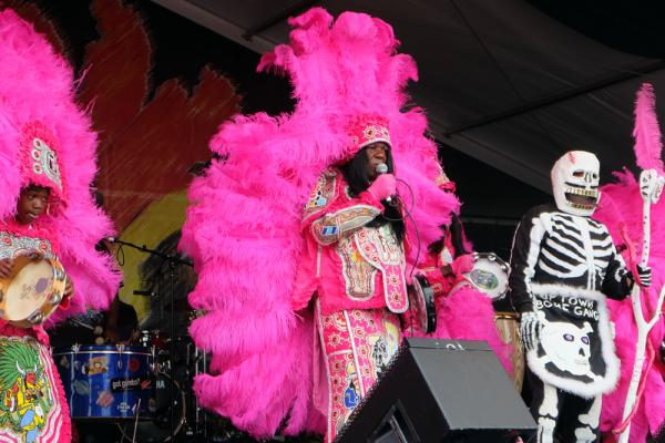 Big Chief Monk Boudreaux performs with the Golden Eagles and a member of a Skull & Bones gang on Sunday, April 27 at Jazz Fest.