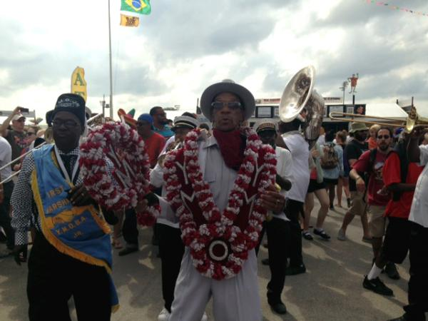 The Young Men Olympians Benevolent Association parades through the Fairgrounds to the tunes of the Tornado Brass Band on Sunday, April 27.