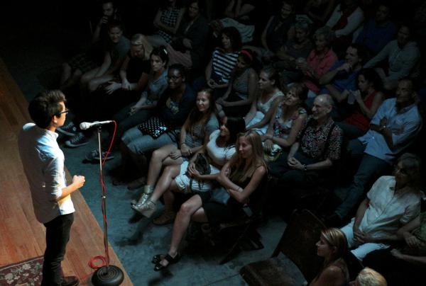 Charles Lin regales the crowd with a tale of love found, and lost again, at the July Moth StorySLAM.