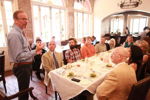 Michel Nischan speaks with a group of New Orleans food enthusiasts at Tableau earlier this summer. His involvement in food policy has shifted how federal dollars are used to combat poverty.