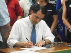 Walker signing ATV bills in Tomahawk 6/21