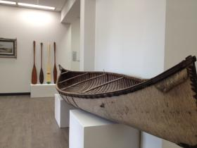 """""""The Art of Hunting and Fishing"""" features a birch bark canoe crafted by a Wisconsin artist."""