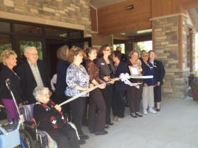 Staff, patients and community leaders gathered for the ribbon-cutting at Rennes Health and Rehab Center.