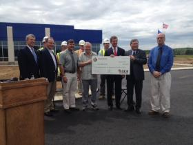 State and local dignitaries posed with a giant TEA grant check for almost $460,000.