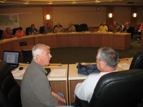 Supervisors Sonny Paszak(L) and Greg Berard and the rest of the Oneida County Board in special session 9/3