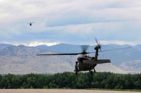 Rescue crews helped evacuate Fort Carson, Colorado after flooding shut down roads in the area.