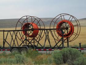 Laying fiber optic cable in a rural area can be difficult and expensive.