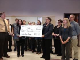AT&T presented the $30,000 check to students and teachers at Rhinelander High School.