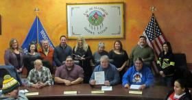 President Tom Maulson(with papers) and the LDF Tribal Council at the transfer of Strawberry Island to the tribe.