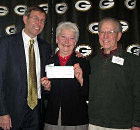Green Bay Packers Foundation Trustee Judge John Zakowski(left), GHT representatives Lauri Gerlach and Gary Meister