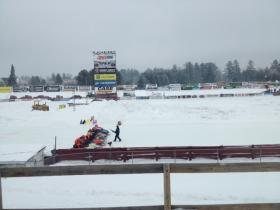 Vintage snowmobiles race in the qualifying rounds at the Eagle River Derby Track.