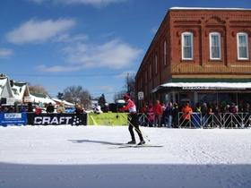 After skiing more than 30 miles, Birkie competitors arrive in downtown Hayward.