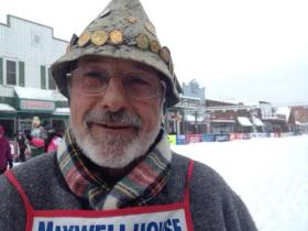 Horst Abel's hat features pin from 22 years of skiing the Birkie.