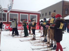 Nikkerbeiner skiers line up, sporting their finest knickers, sweaters and wool socks.