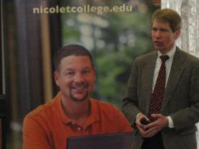 Revenue Sec. Rick Chandler in front of Nicolet College image