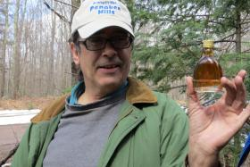 "Paul DeMain shows off the syrup ""Penokee Gold."""