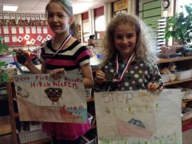 Elise Tesch (left) and Reagan Hartman won second and first place in the 4th/5th grade poster contest division.