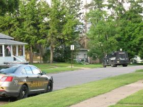 Law enforcement, including Special Response Team, at Pelican Street residence Tuesday evening.