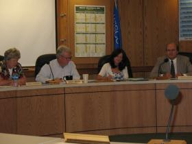 Supervisors Carol Pederson(left,) Board Chair David Hintz(second left), Lance Krolczyk(right)
