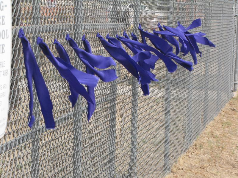 Outside the incident compound, people tied ribbons in support of the lives lost.