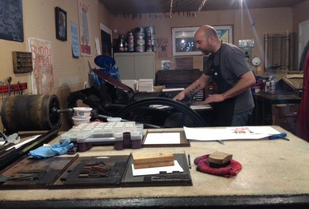 Daniel Goscha is at work printing end-of-year cards for Arts Wisconsin.