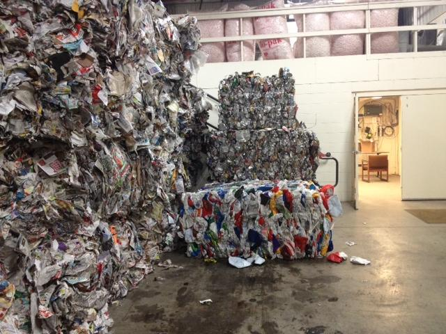 Bales of tin cans and aluminum are ready for pick-up.