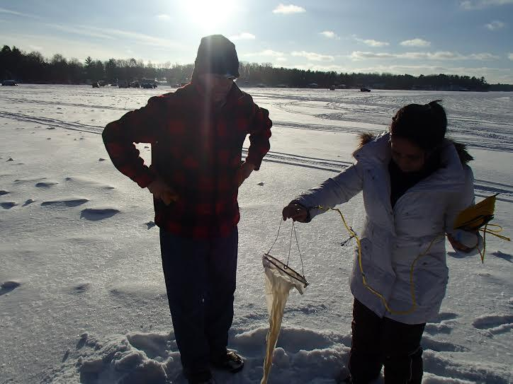 Students use a special net to trap living organisms like zooplankton.