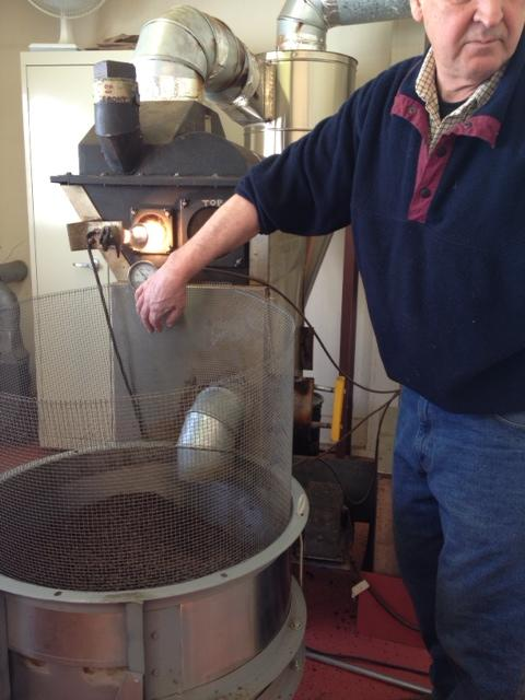 Dave Roberts prepares to operate his small-batch roaster.
