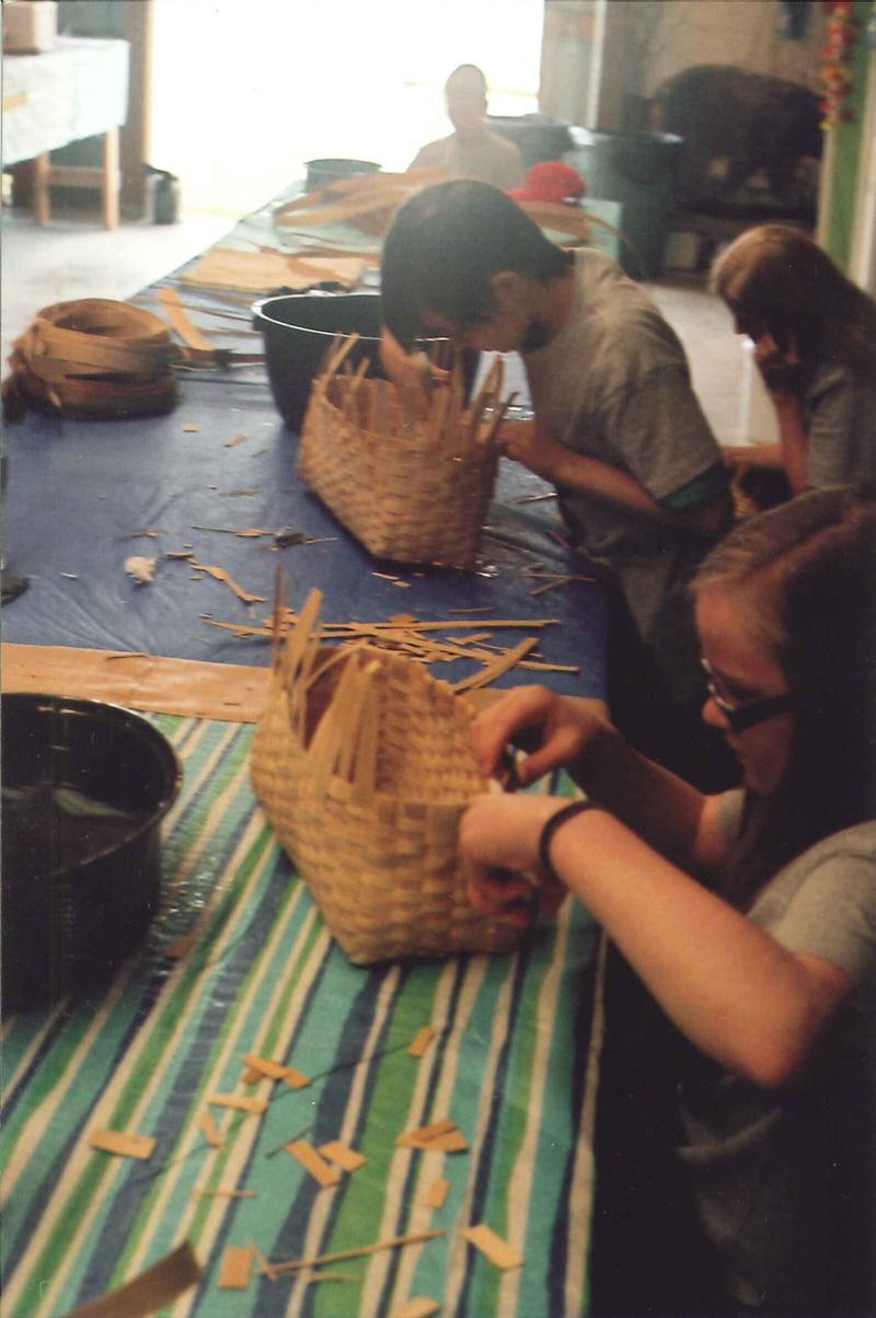 By day two of the workshop, kids are on the home stretch of their basket weaving.